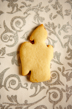 Cookie with angel shape on decorative surface