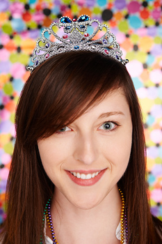 Portrait of smiling young adult woman in tiara