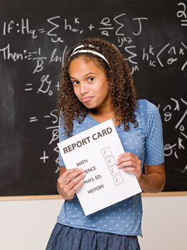 Teenage girl holding report card with failing grades