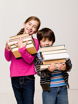 Boy and girl holding heavy books