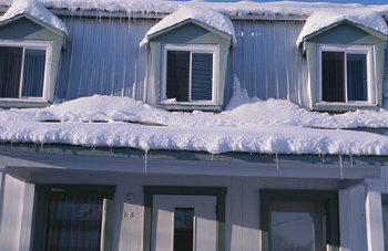 Close-up for snowcovered house
