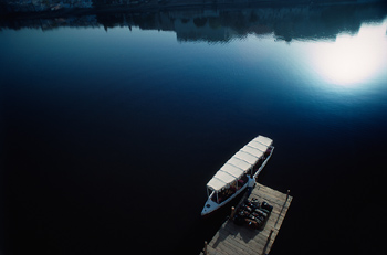 High angle view of person standing on dock by boat