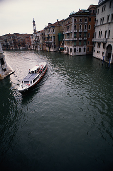 Boat driving on canal in Venice