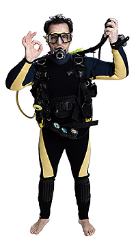 Diver in scuba equipment gives ok signal