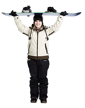 Woman holding snowboard on her head