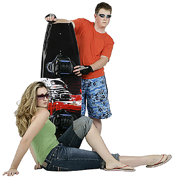 Two Teenagers Posing with Wakeboard