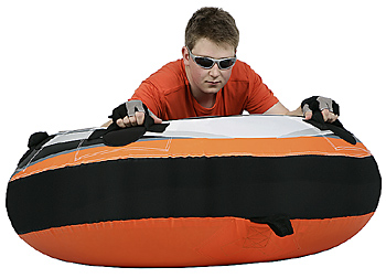 Teenage Boy Laying on Inner Tube