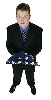 Downcast Businessman Holding American Flag
