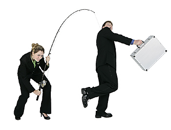 Businesswoman Hooking Businessman on Fishing Pole