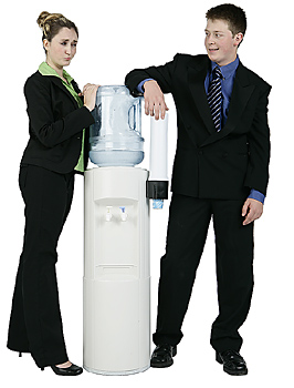 Businessman and Businesswoman at Water Cooler
