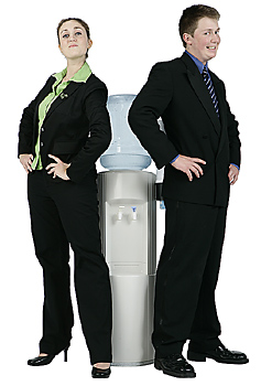 Businesswoman and Businessman at Water Cooler