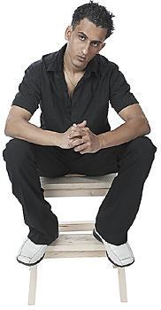 Man Sitting on Stool, Deep in Thought