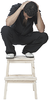 Frustrated Man Sitting Atop Stool