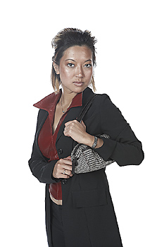 Young Woman in Suit with Purse