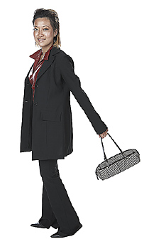 Young Woman in Suit Carrying Purse