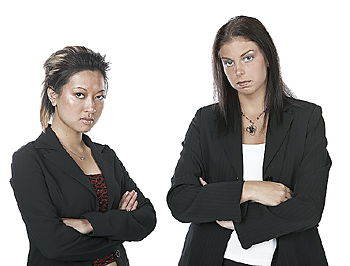 Young Businesswomen Staring with Arms Crossed