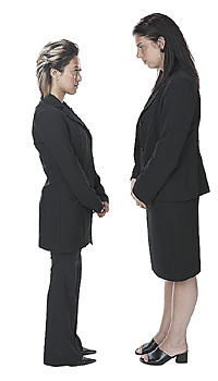 Young Businesswomen Staring Face to Face