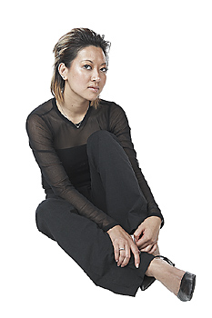 Young Woman Sitting and Staring