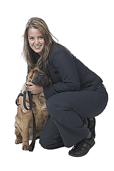 Young Businesswoman Crouching with Pet Dog