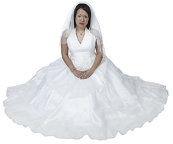 Young Woman in Wedding Dress Sitting