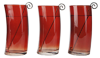 Red curved cups with stirrer