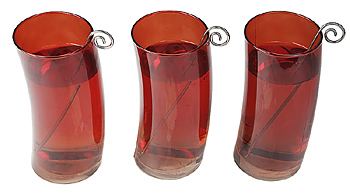 Red curved cups with stirrers