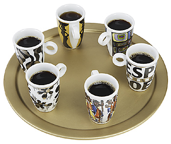 Cups of coffee on circular serving tray