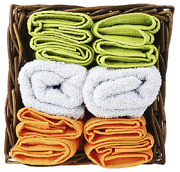 Wicker basket with rolled towels