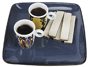 Two cups of coffee and wafers on tray