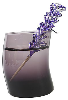 Drink in curved glass with decorative toothpick