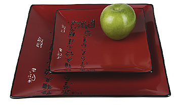 Apple atop square Asian plates