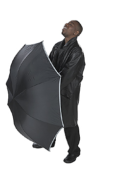 Young Man in Suit Standing with Umbrella