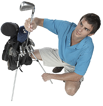 Man pulling out golf club from bag