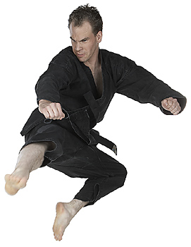 Male martial artist kicking