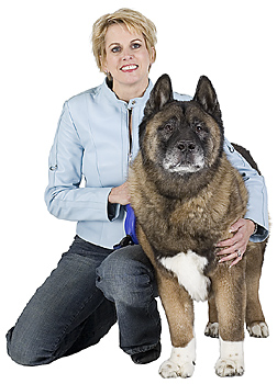 Woman posing with dog