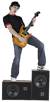 Teen rocker playing guitar on amplifiers