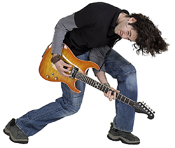 Teenage musician rocking out with guitar