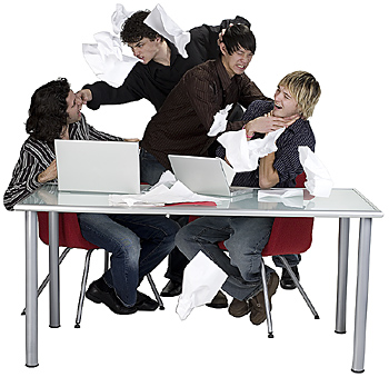 Group of teenage boys fighting at table