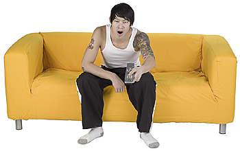 Man on sofa with remote control