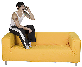 Man on sofa with cell phone