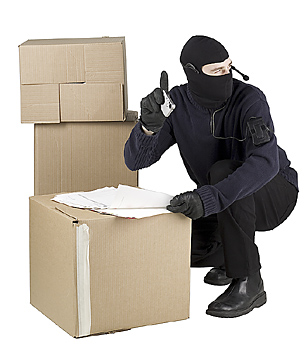 Spy in ski mask taking pictures of documents