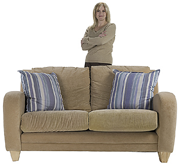 Woman posing by couch
