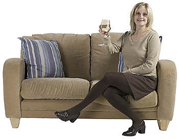 Woman relaxing on couch with glass of wine