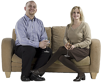 Couple posing together on couch