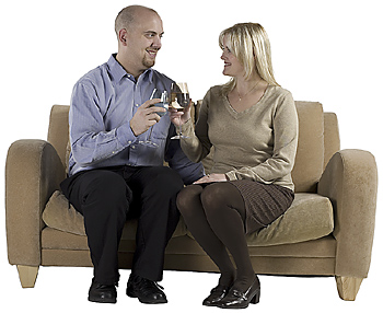 Couple clinking wine glasses