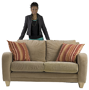Woman standing behind sofa
