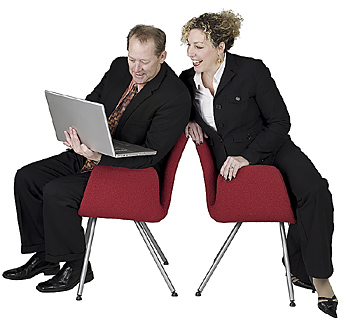 Businessman and businesswoman using computer
