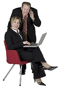 Businessman and businesswoman posing together