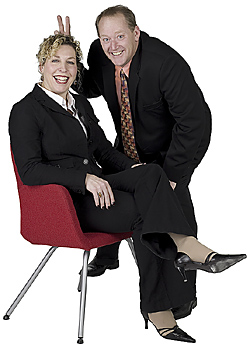 Businessman and businesswoman in humorous pose
