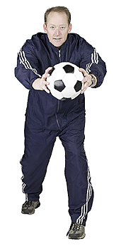 Mid-adult man posing with soccer ball